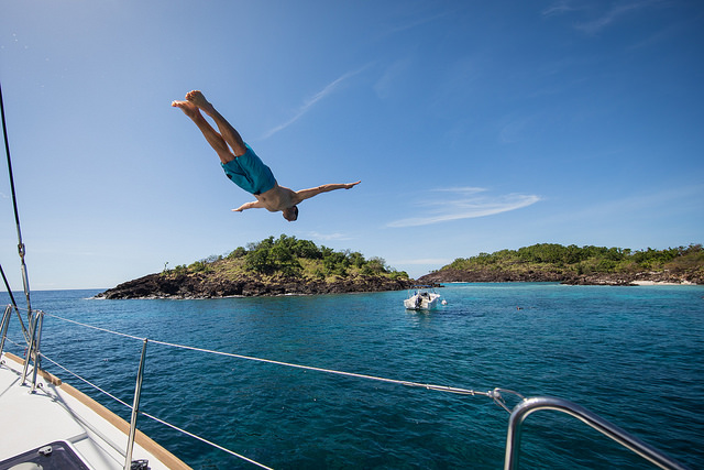 Young man diving from a yacht.