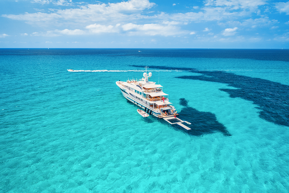 luxury yacht charter with jet skis and pool